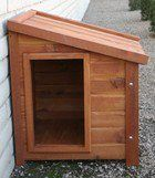 """Dog house"" is actually hidden access to a doggie door, providing visual & physical security against intruders."