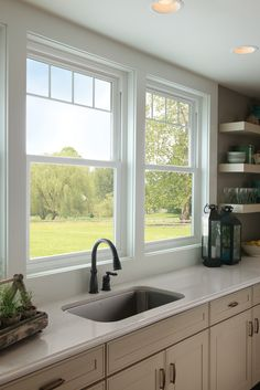 Valence grids give these kitchen sink windows a new sophistication. Featured: Tuscany® Series.