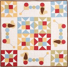 """""""Baby's Bow Wow"""" quilt pattern by Bonnie Sullivan, appliqued with puppy pull toys"""