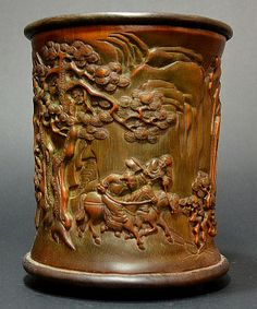 Bamboo brush pot, carved with figures and characters and mounted with a Zitan rim and stand.
