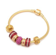 The Royal Fuchsia Golden Charm Bracelet Vegas Collection is a delightful golden charm bracelet thatevokes warmth, refinement and extravagance, all encompassed in its exquisitedesign. Summery, elegant and playful, the bracelet includes a.925 sterling silver gold tone snake chain and seven(7) charm beads artfully arranged arounda charm with fuchsia crystals.The 3mm.925 sterling silver gold tone snake