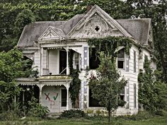 Abandoned house. rural Missouri.. Oh how I hate to see a Victorian fall to ruin!