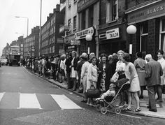 1969: A large queue of commuters wait for a bus during a one-day strike by London Underground. Hulton Archive / Getty