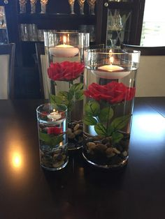 Table centerpiece decorations for Beauty and the Beast inspired party. Cylinder vases with red rose and floating candle Table centerpiece decorations for Beauty and the Beast inspired party. Cylinder vases with red rose and floating candle Party Table Centerpieces, Floating Candle Centerpieces, Centerpiece Decorations, Birthday Decorations, Vases, Diy Flower Centerpieces, Black And Gold Centerpieces, Easy Decorations, Dessert Tables