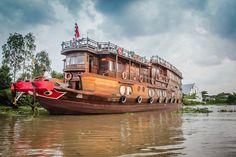 Mekong Delta Mekong Eyes Vietnam http://www.divergenttravelers.com/colors-mekong-delta-photo-essay/ #mekongdelta #Vietnam #mustsee #riverboat #handspandtravel #divergenttravel #divergenttravelers #bestblogpostof2014 #bestblog #mustread #travel #photos #mekongeyes