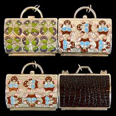 A set of four Judith Leiber for Neiman Marcus enameled silver toned pill boxes/keychains in the shape of a purse. One features an alligator design, another has butterflies with pink Swarovski crystals and two have teddy bears