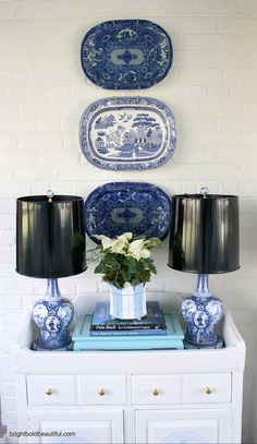 Decorating with blue and white plates nd a white poinsettia - simple holiday decorating ideas