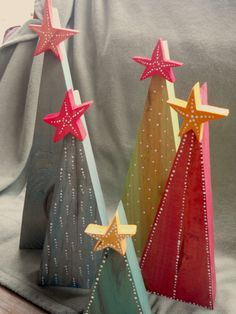 Primitive Wooden Christmas Trees with Stars. The trees are made from found wood, stained, and painted with white dots. Cute with barb wire stars??