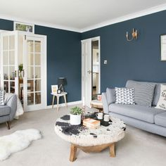 Step inside this modern Scandi family home in East Sussex Be inspired by this modern four-bedroom detached house in East Sussex with moody blue interiors and Scandi-style looks that are brimming with character Living Pequeños, Scandi Living Room, Navy Living Rooms, Blue Living Room Decor, Living Room Color Schemes, Living Room Paint, Living Room Grey, Home Living Room, Scandinavian Living