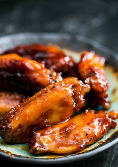 Perfect for game day! Tasty chicken wings with a glaze made with Bourbon whisky and maple syrup. BEST WINGS EVER. On SimplyRecipes.com #Bourbon #ChickenWings #GameDayRecipe