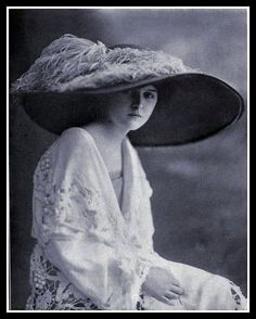 1912 Edwardian Fashion. Her hat is fabulous--as is the lacework on her dress. She was a woman of great means for sure!!