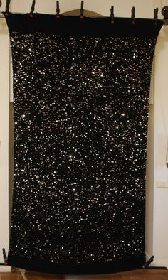 Absolutely gorgeous black Moroccan wedding blanket from Red Thread Souk.  Like a starry sky with you the master of the universe.