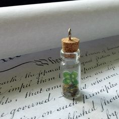 Med four leaf clover bottle terrarium pendant by beadingmom