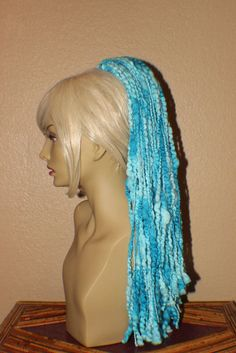 This is a 23' long hair fall, it is a aqua blue color fade medium to light aqua blue this fall creates a full and fluffy ponytail or a bun you can wear any time to add some fun to your day.
