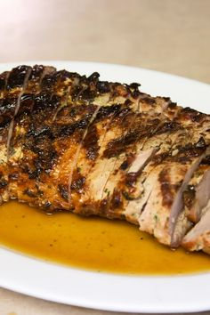 Recipe including course(s): Entrée; and ingredients: brown sugar, cinnamon, garlic powder, olive oil, onion, pork tenderloin, sherry, soy sauce