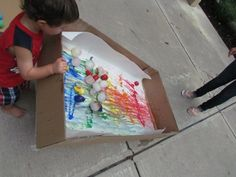 Painting with Ice Balls (made with little balloons) on Freezer Paper.  (Art & Science connections)