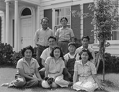 Japanese-American members of the Shibuya family posing for a family portrait shortly prior to being forcibly evacuated from their home, Mountain View, CA,18 Apr 1942 (US National Archives, Dorothea Lange, photographer)