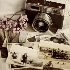 Vintage camera and prints