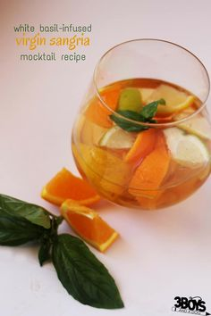 A delicious and refreshing basil-infused mocktail recipe for entertaining. A year-round favourite, this Virgin Sangria Mocktail Recipe is a fun twist on an Italian classic. Virgin Sangria, Mocktails For Kids, Grape Juice, Juice 2, Sparkling Drinks, Sangria Recipes, Classic Italian, Non Alcoholic Drinks, Lemon Lime
