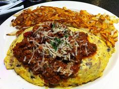 Check out the Maserati omelet at the #Peppermill in #Vegas. It has sausage, Jack and cheddar cheese and mushrooms, smothered in Italian meat sauce and sprinkled with Parmesan.