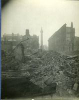 """Post-1916 Rising Dublin General Post Office (GPO) showing extensive damage - Desmond FitzGerald Photographs, UCD Digital Library - """"The photograph has been taken from Henry Street. Many of the buildings on Moore Street and Henry Street have been totally demolished. Nelson's Pillar is silhouetted against the skyline."""""""