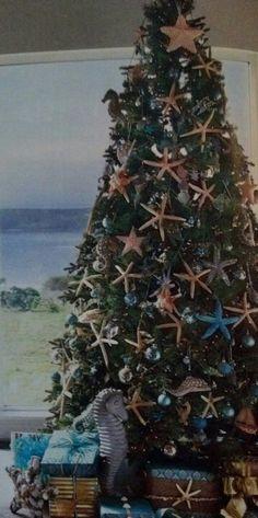 Nautical beach Christmas tree. a little more on the beach side.. but i like the starfish
