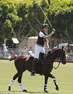 William playing in a polo match while he and Kate were in America.