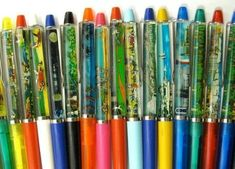 Pens with liquid scenes in them. 1l980's style. haha so cool better than the plain pens we have now lol