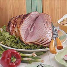 5 Star Ham...  Prep: 10 min. Bake: 2 hours - 1 large onion (sliced), 2 tablespoons butter, 1 fully cooked spiral ham (7 to 9 pounds),1-1/2 cups chicken broth, 1 cup red wine (or additional chicken broth).  Saute onion in butter until tender; transfer to roasting pan. Place ham on top. Pour broth and wine over ham. Bake, uncovered, at 325° for 2-3 hours or until a meat thermometer reads 140°