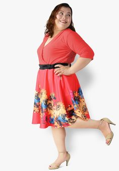 Jazz up a work day or enliven a party wearing this match! Overlap spandex top to floral neoprene skater skirt, gartered waist. An outfit that'll make you cherish this day more!