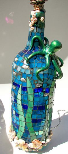 Made from a recycled wine bottle, stained glass, shells, beads, polymer clay