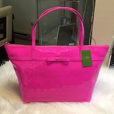 "Kate Spade Hot Pink Large Tote  Brand-new with tags attached Kate Spade hot pink patent leather large tote. Measures 15"" in length and 11"" in height. Very good size tote to hold everything you need! Kate Spade icon is featured on front of bag, complete with a cute bow! kate spade Bags Totes"