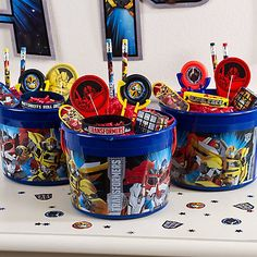 Put together bucket favors for the crew Load up Transformers Favor Buckets with colorful paper shred and add a disc shooter, a paddleball, pencils, stickers and a skateboard keychain and your Transformers fans will leave the party happy. 5th Birthday Party Ideas, Birthday Favors, Birthday Fun, Power Ranger Party, Power Ranger Birthday, Transformers 5, Rescue Bots Birthday, Transformers Birthday Parties, Transformer Birthday