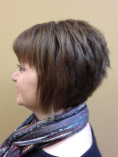 This haircut is an example of a textural inverted bob with a bang.