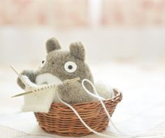 Look! It's Totoro and he's knitting! This is so amazingly cute!
