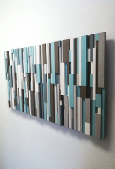 "Gallery Price: $900  Artist: Eric & Adam Title: ""Cooling Strips"" Size: 48W x 24H Style: Modern Wood Art / Wood Strip Art / Wooden Wall Art Colors: Turquoise, Brown, White, Grey, Charcoal (colors can be customized upon request)  100% Handmade wooden art Ships worldwide from Cincinnati, Ohio Please Note: the original has been sold, but I can recreate a similar variation with the same colors and structure, or I can customize the color scheme upon request.  With a nod to traditional rustic decor…"