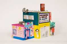I much prefer having the kids make creative homes/stores instead of buying premade plastic dollhouses etc. These are perfect examples