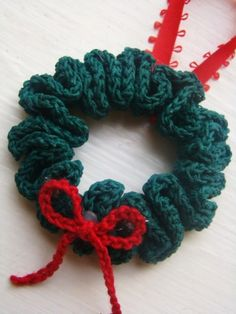 Christmas Wreath Ornament ~ free pattern...I would cut a little ring from a plastic lid and crochet the 30 sc's onto the ring and not bother with the starching part....Helen