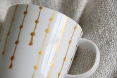 painted porcelain cup in gold  http://www.provinzkindchen.com