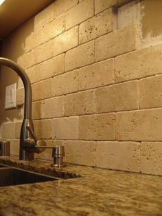 Our kitchen backsplash: Travertene, subway tiles, stacked, not grouted. LOVE it!