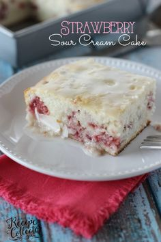 Strawberry Sour Cream Cake – A moist sour cream white cake filled with fresh strawberries and topped with a quick lemon glaze
