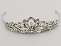 Item# TIA550791  This tiara from the Sheryl Marie Collection will have you feeling like a princess with this regal tiara. This dainty tiara that lends a touch of old fashion glamor to your hair.   Measuring approximately 1-1/2 inches high, this tiara will compliment your wedding veil or add a beautiful finishing touch on its own. Each side of the tiara has tiny loops on the ends to attach your wedding veil.   Wear this tiara alone or with a veil; hair up or down.