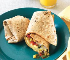 Host a #Superfood Lunch: Egg, Bean and Veggie Wrap. Lean beans deliver brain-boosting folate and energizing iron, and the eggs will help you fight fat. #SelfMagazine