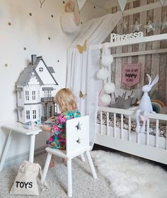 This little girl has the sweetest room. I'm sure my baby girl would play with this dollhouse for hours!