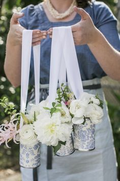 DIY tutorial May Day Door Hanger ~ Decorated tin cans & beautiful spring flowers ~ Arrangements by Valley & Company Events and Laura Marchbanks Photography The Doors, Tin Can Crafts, Crafts For Kids, Spring Crafts, Holiday Crafts, Spring Projects, May Day Traditions, Holiday Traditions, May Day Baskets