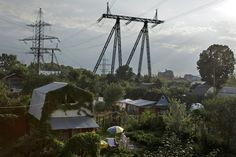 RUSSIA. Pirogovo. 2011. Dacha community that lies directly under large electrical pylons.