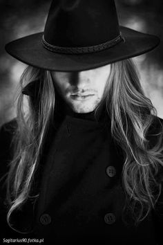 mysterious...and yeah, the hair...and the hat...and the scruff...that's it