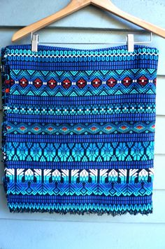 Blue. Teal. Red. Woven. Mexican blanket! Would make a wonderful cuddle-up blanket.