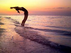 yoga on the beach at sunrise? Yes PLEASE. <3