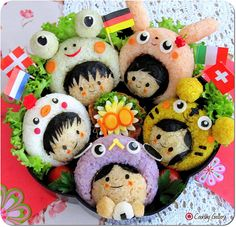 Happy Children Bento... though it might be a little creepy to eat their heads...